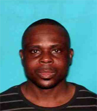 Jose Johnson Odusola, wanted fugitive by the USA Postal Inspection Service